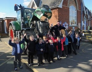 School children with Sam Fairs & his tractor